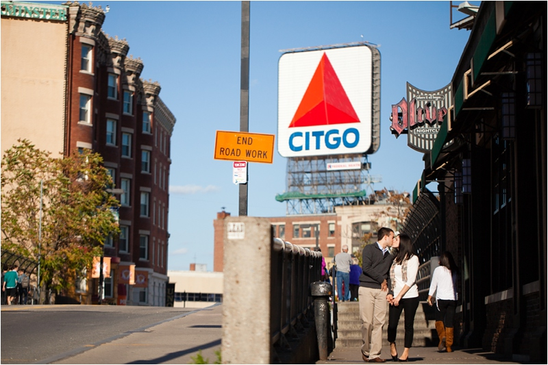 couple walking in front of the citgo sign