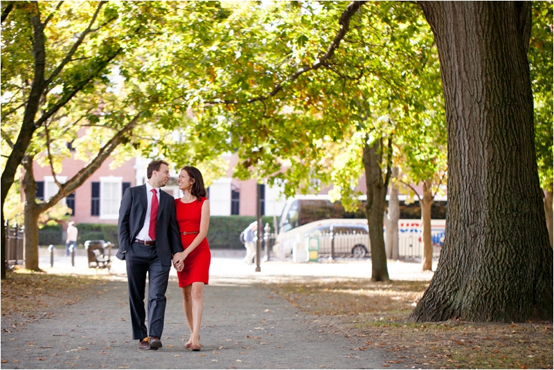 couple walk through Salem Commons in Salem Massachusetts