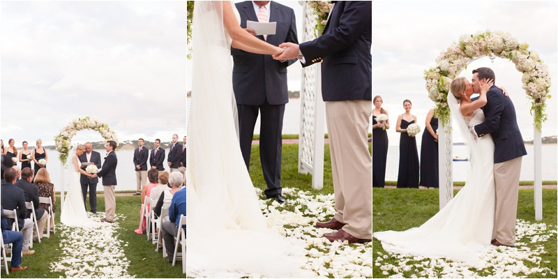 white floral arbor at wedding on massachusetts coast