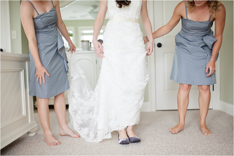 bride wears ballet flats down maine coast wedding aisle