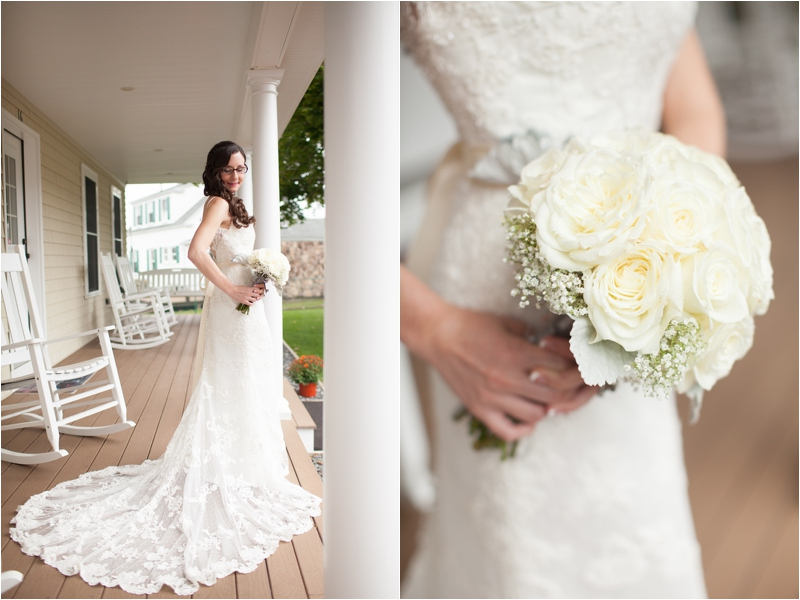 bride poses on porch with lacy long train at coastal cottage