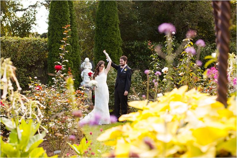 dancing image of bride in groom in blooming may flowers