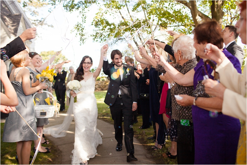 bridal party waves streamers to celebrate maine couples wedding