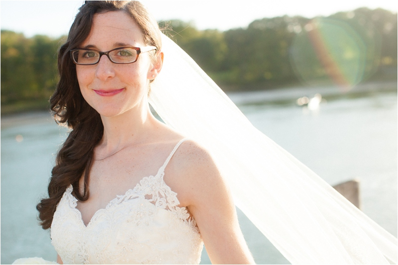 bride on maine coast smiles for pictures on wedding day