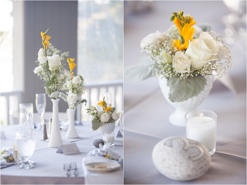 daffodil and white roses elegantly decorate the table at coastal themed wedding