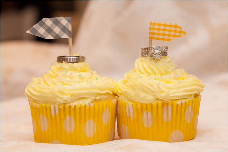 cupcakes topped with rings celebrate the union at new england seacoast wedding