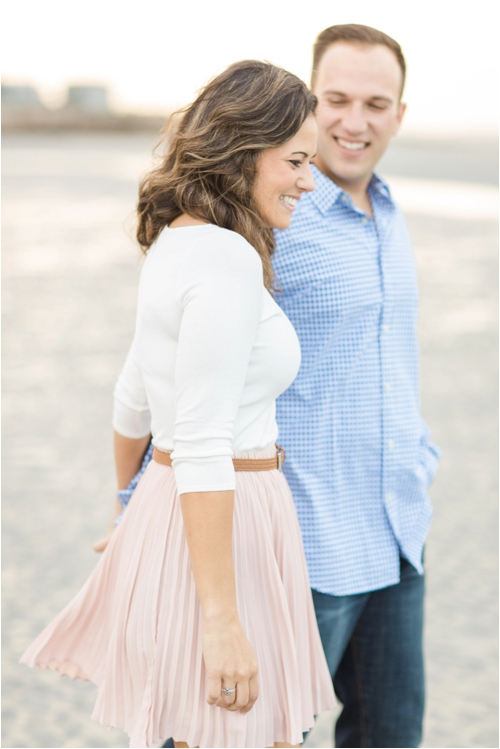 Summer engagement session at the beach photographed by Deborah Zoe Photography.