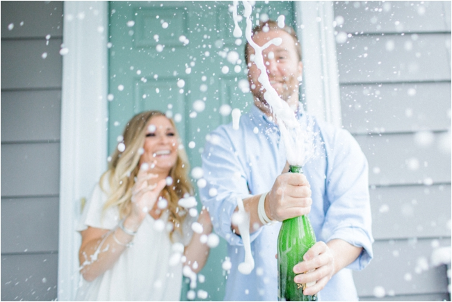 Couple celebrate engagement with champagne photographed by Deborah Zoe Photography.