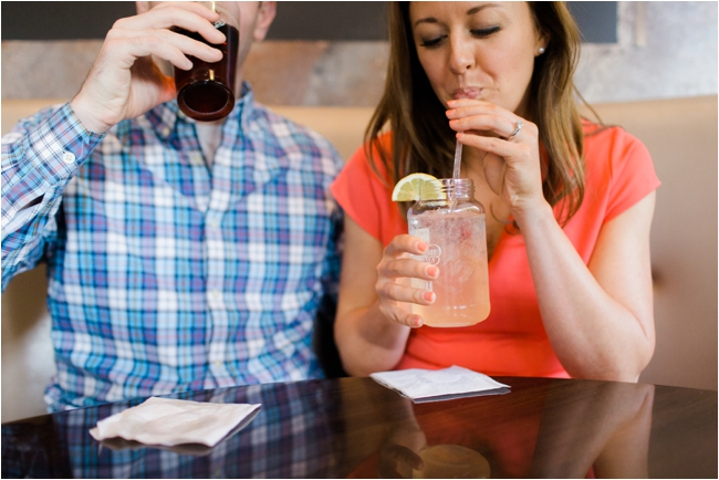 Couple enjoy drinks before their engagement session photographed by Deborah Zoe Photography.