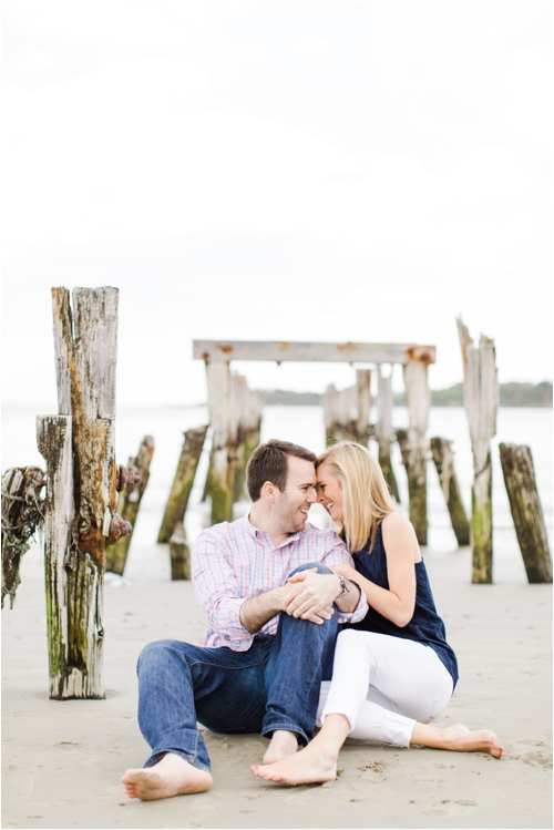 Couple embrace on the beach photographed by Deborah Zoe Photography.
