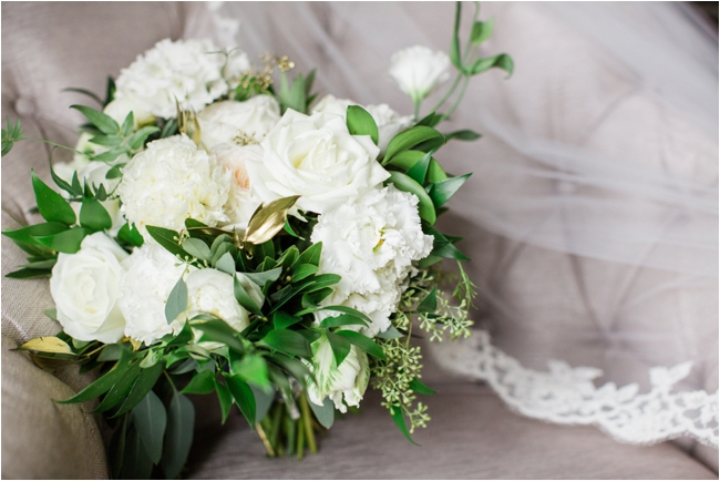 Asymmetrical wedding bouquet in gold and cream photographed by Deborah Zoe Photography.
