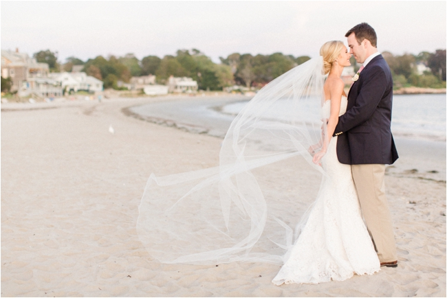 Couple on beach in fall wedding day photographed by Deborah Zoe Photography.