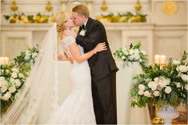Couple share first kiss during their fall Boston wedding photographed by Deborah Zoe Photography.
