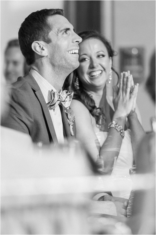 Couple react to wedding toasts photographed by Deborah Zoe Photography.