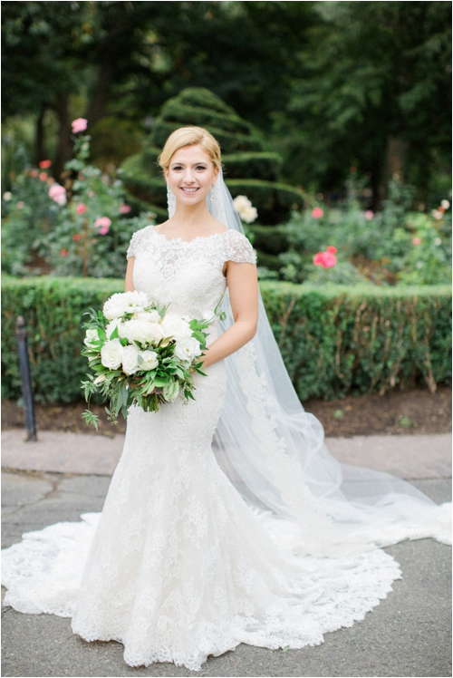 Bride in detailed lace wedding dress Boston Public Garden photographed by Deborah Zoe Photography.