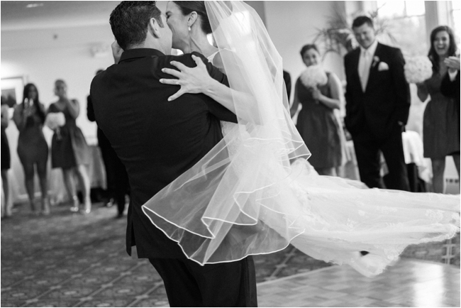 Couple twirl during first dance photographed by Deborah Zoe Photography.