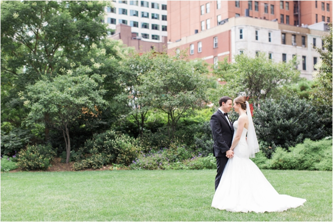 Couple on wedding day in Boston Rose Kennedy Greenway photographed by Deborah Zoe Photography.