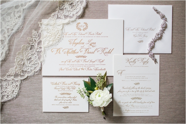 Gold embossed wedding invitation suite photographed by Deborah Zoe at the Fairmont Copley Plaza