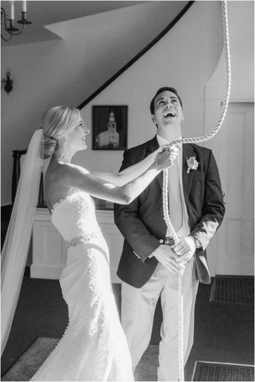Bride and Groom ring the church bell after ceremony on their wedding day photographed by Deborah Zoe