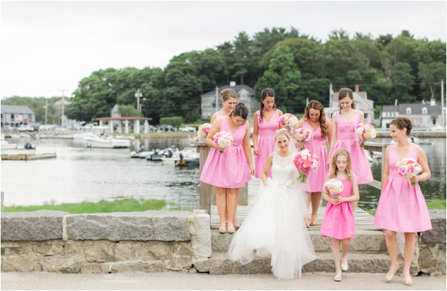 Bride surrounded by Bridesmaids in pink dresses on wedding day photographed by Deborah Zoe Photograp
