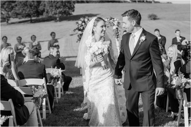 Couple walk down the aisle during summer outdoor wedding photographed by Deborah Zoe Photography.