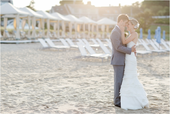 Bride and Groom embrace on the beach at Chatham Bars Inn photographed by Deborah Zoe Photography.