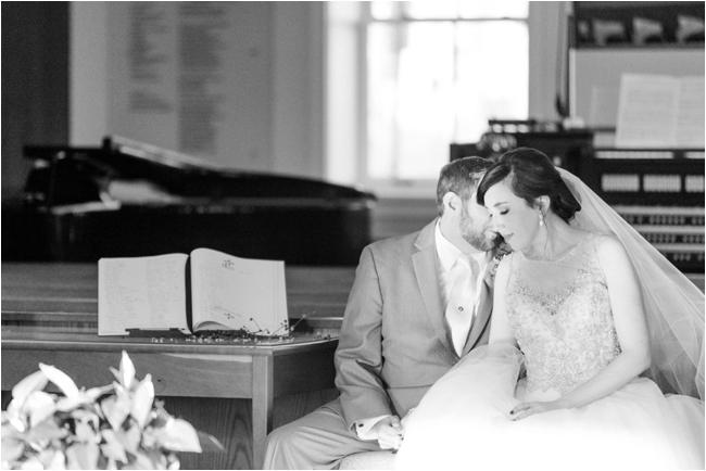 Bride & Groom during ceremony by Deborah Zoe Photography.
