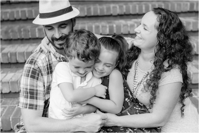 Family cuddle session in New Hampshire photographed by Deborah Zoe Photography.