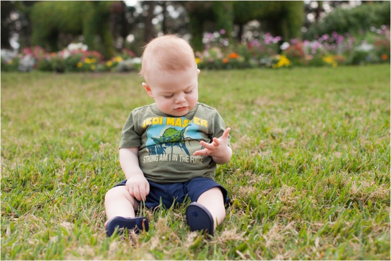 Baby on grass in front of Walt Disney's Wilderness Lodge
