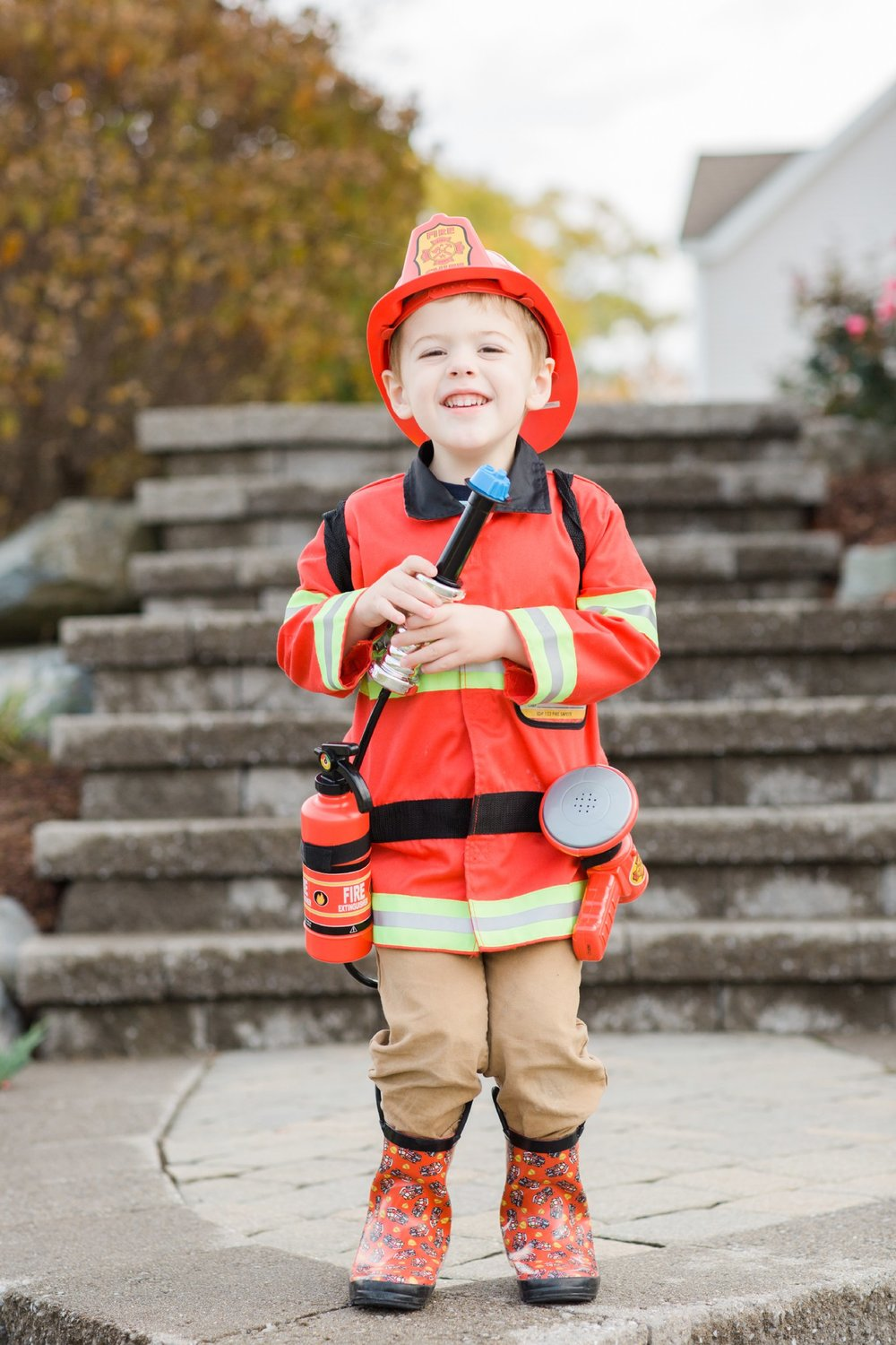 And in 2016 - our little Fire Chief!! This was an absolute miracle that I got him to smile -- he just kept running everywhere trying to put out fires!