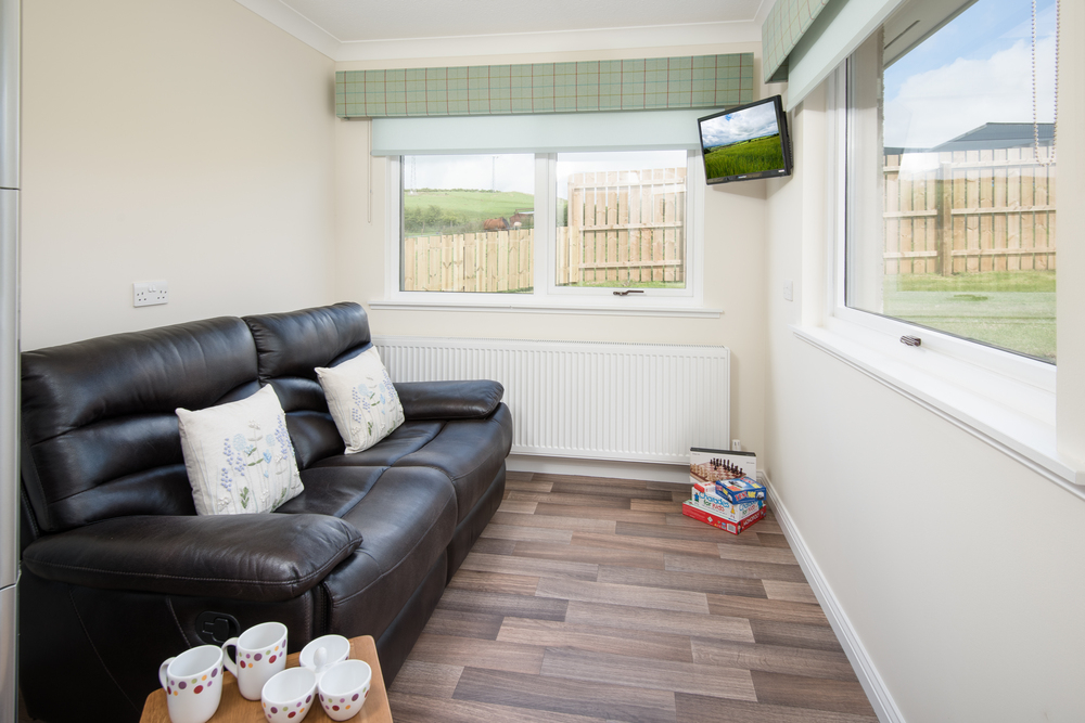 Adjacent to the kitchen is a lovely, bright room with additional seating where you can relax, read or watch films on the wall mounted TV with DVD/CD player. A Wii has also been provided for your enjoyment.