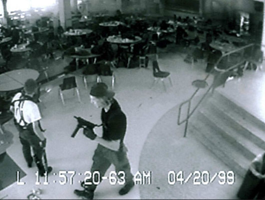 Eric Harris  (left)  and Dylan Klebold  (right)  caught on the Columbine High School's security cameras in the cafeteria, 11 minutes before their suicides