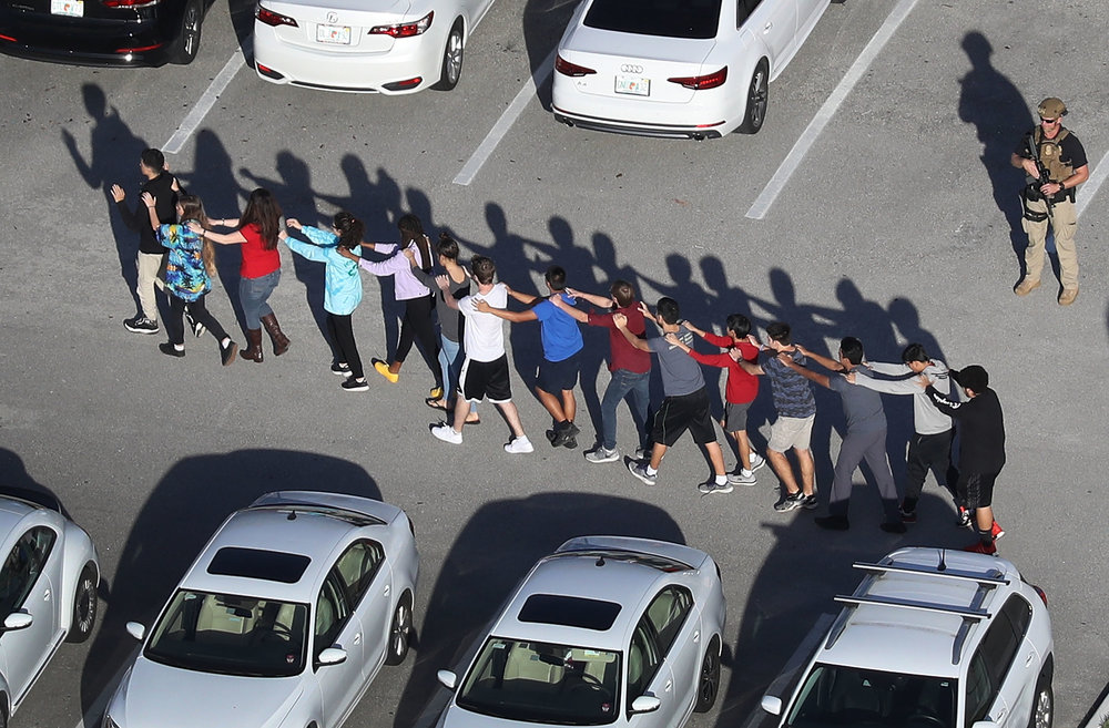 People are brought out of the Marjory Stoneman Douglas High School after a shooting at the school that reportedly killed and injured multiple people on February 14, 2018 in Parkland, Florida. Joe Raedle/Getty Images