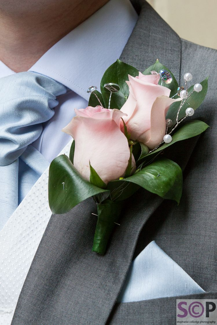Grooms buttonhole with roses