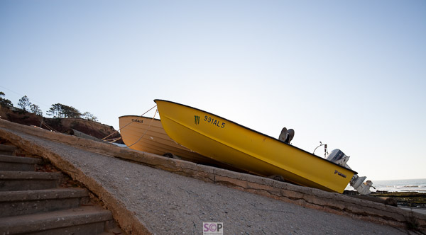 small yellow boat on beach