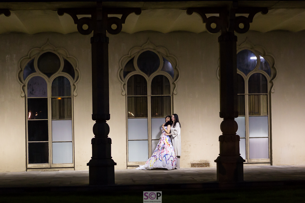 same sex couple at brighton pavilion at night.jpg