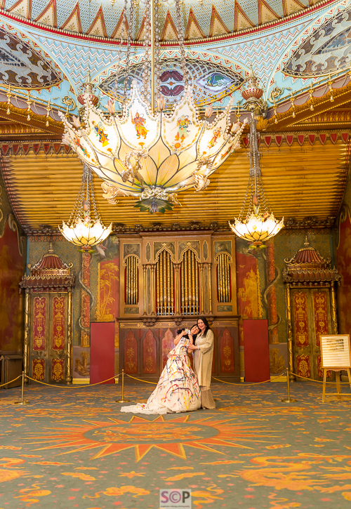 same sex couple in the music room at brighton pavilion.jpg