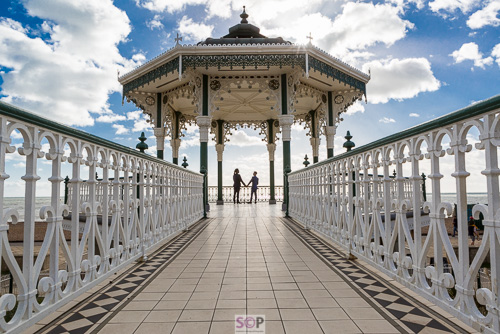 lgbt couple on brighton bandstand