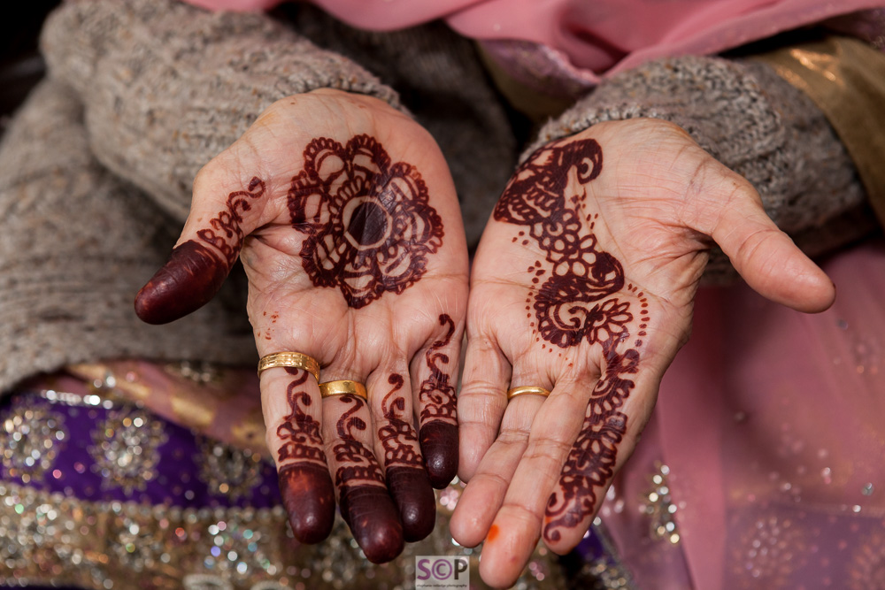 detailed mehndi on hands open palms