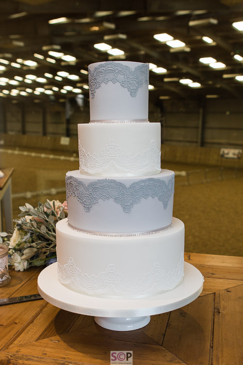 dove grey and white four tier wedding cake