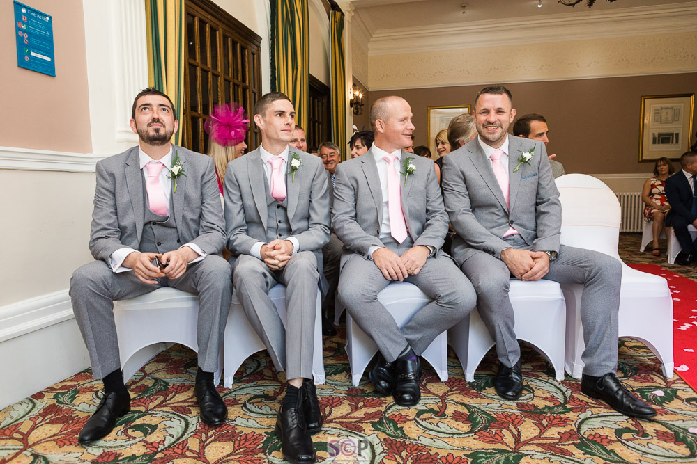 groom with batsman and groomsmen seated before service