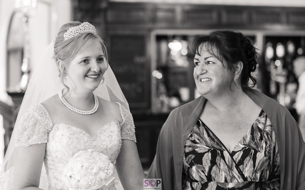 bride with her mum looking at her proudly