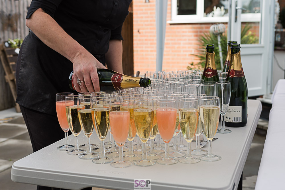 Champagne being poured into glasses at reception