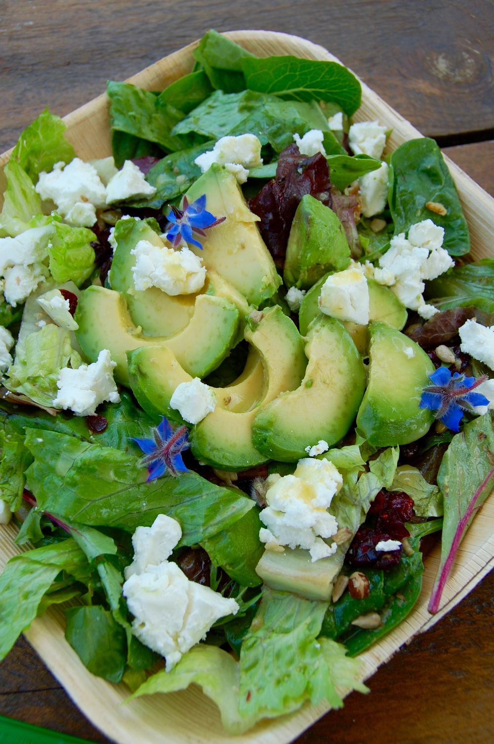 Buttery avocado + edible flowers + super creamy feta + farm-fresh greens = perfect salad