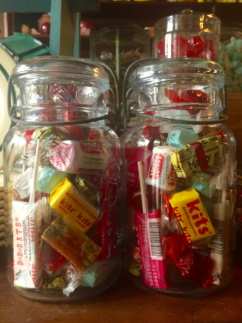 Classic candy in an vintage wire side jar makes the perfect road trip snack for an antique hunter with a sweet tooth.