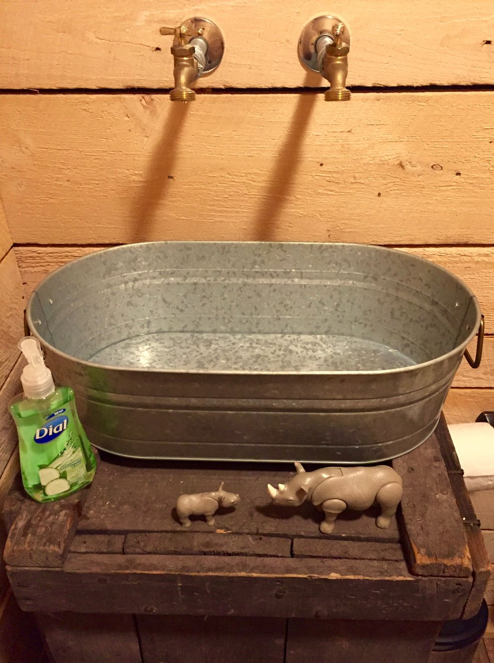 Archer (and his toy rhinos) loved the rustic sink in Hop Barn's bathroom.