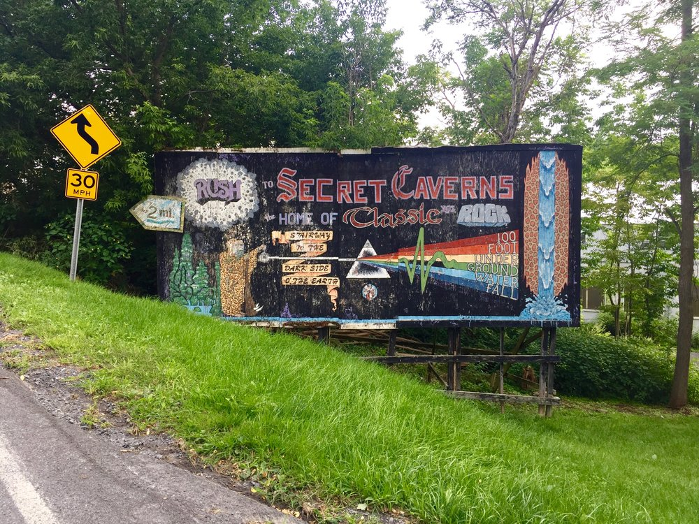 secret caverns sign
