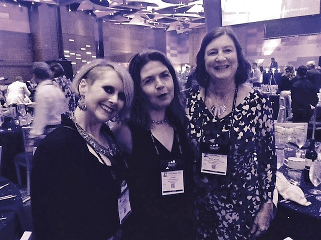 Meg and two of her awesome co-workers at a recent North American CF Conference