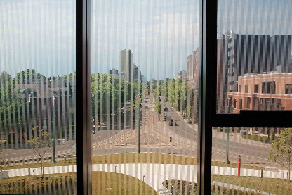 The windows from the fabrication lab lets you see straight down Spadina Avenue as far as your eye can see to the lake shore. The windows were so neat that we just had to take a silhouette type photo with them.