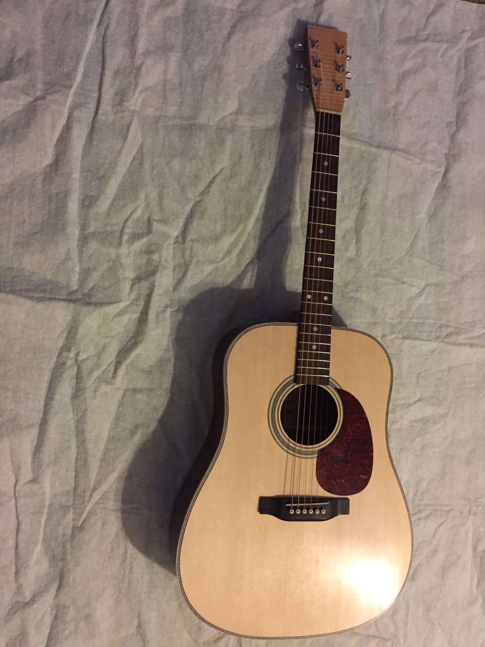 This guitar was donated to a church auction